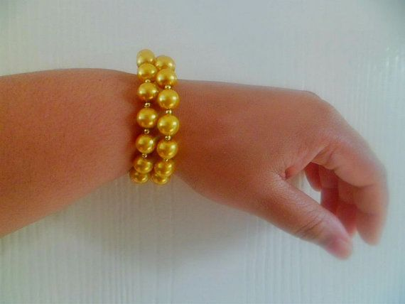 Gold Pearl & Seed Bead Stretch Bangle by JewelsSpeakLouder on Etsy, £5.00