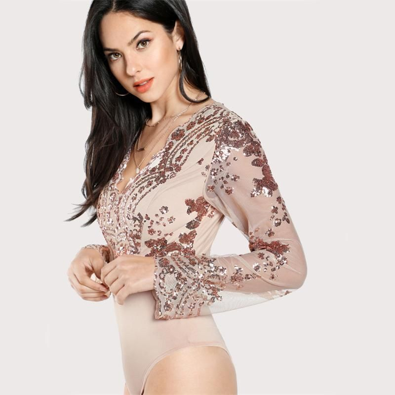 ac5b7b8f9b2c Dazzle all night long in this stunning gold sequin bodysuit! This long  sleeve, nude bodysuit features sheer sleeves and rose gold sequins. Wear  this ...