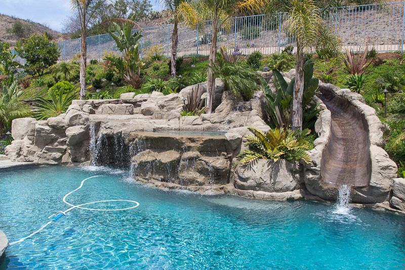 Rock Swimming Pool With A Water Slide Spa Waterfalls And A Cave Pool Waterfall Cool Swimming Pools Dream Backyard Pool