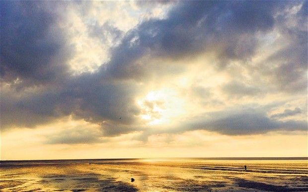 God, well known to work in mysterious ways, might be said to have been at it again when the image of a deity-like bearded man appeared through the clouds over Snettisham, Norfolk. Amateur photographer Jeremy Fletcher took the image as he strolled beside the Wash, the wide estuary between Norfolk and Lincolnshire. Mr Fletcher, of Bray, Berkshire, was in the area for a three-month attachment as a company finance director, and took the photograph on an evening walk. He said: