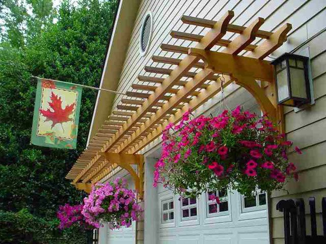 Don't forget to do something by the garage when sprucing up the outside of your house.