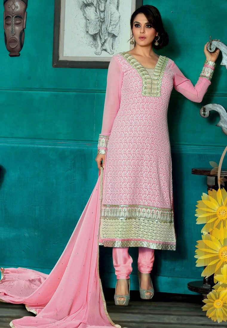 Look pretty in this Pink Color Pure Georgette straight cut suit embellished with a gorgeous path resham embroidered and stone work yoke