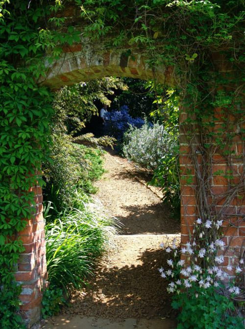 This Fetching Brick Archway Leads Into The Gardens Of Upton House A Country House In Bearsted Warwickshire Brick Archway Archway Garden Landscape Design