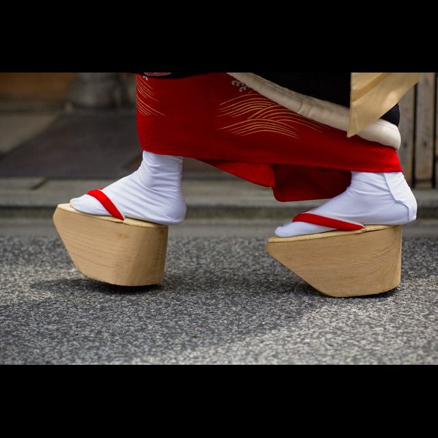 Geta, traditional Japanese shoes (elevated wooden sandals) worn with a  kimono or yukata . in Japan