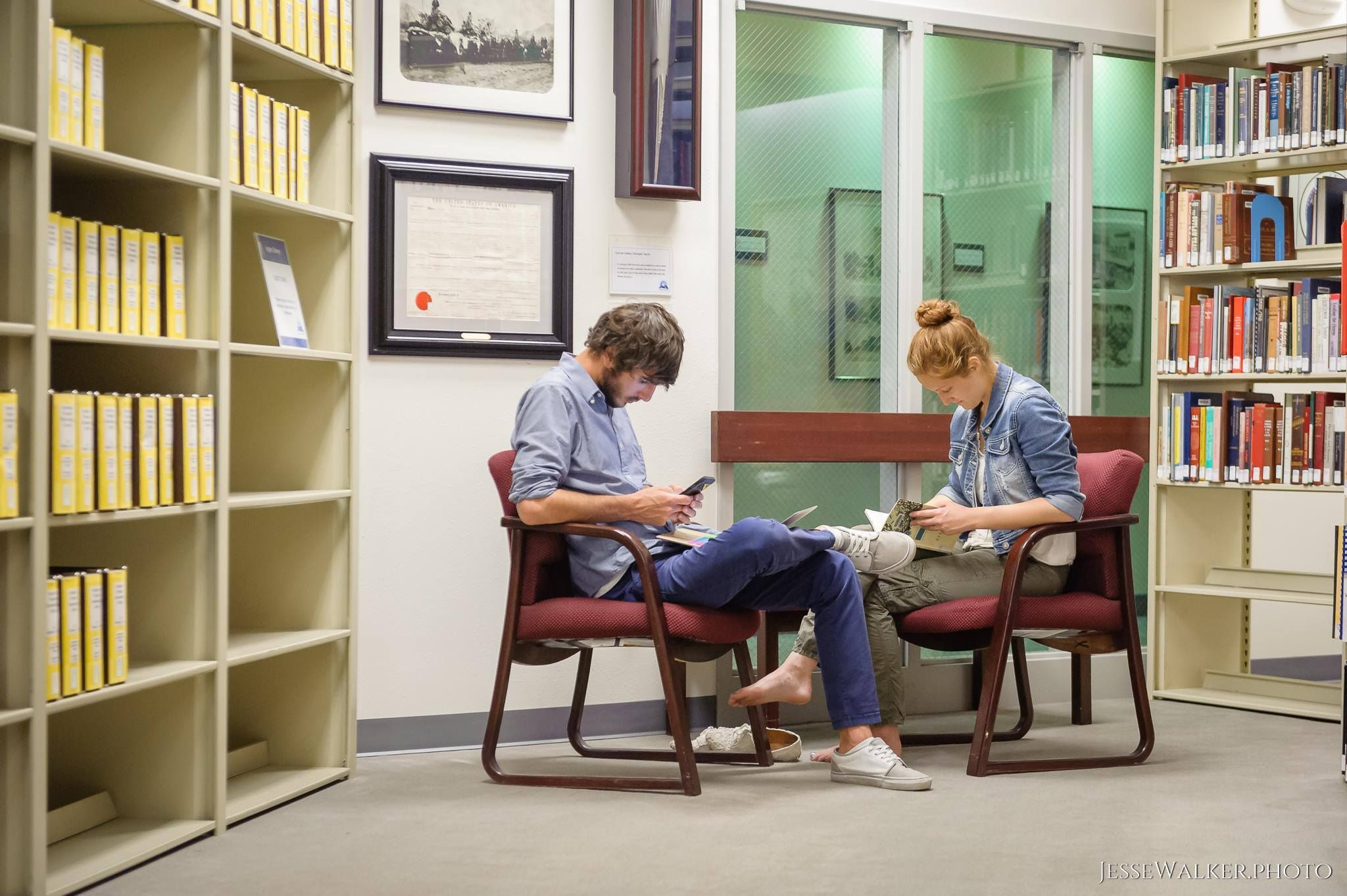 Library patrons have a quiet moment in the Virginia Hansen Special Collections room during our centennial day.