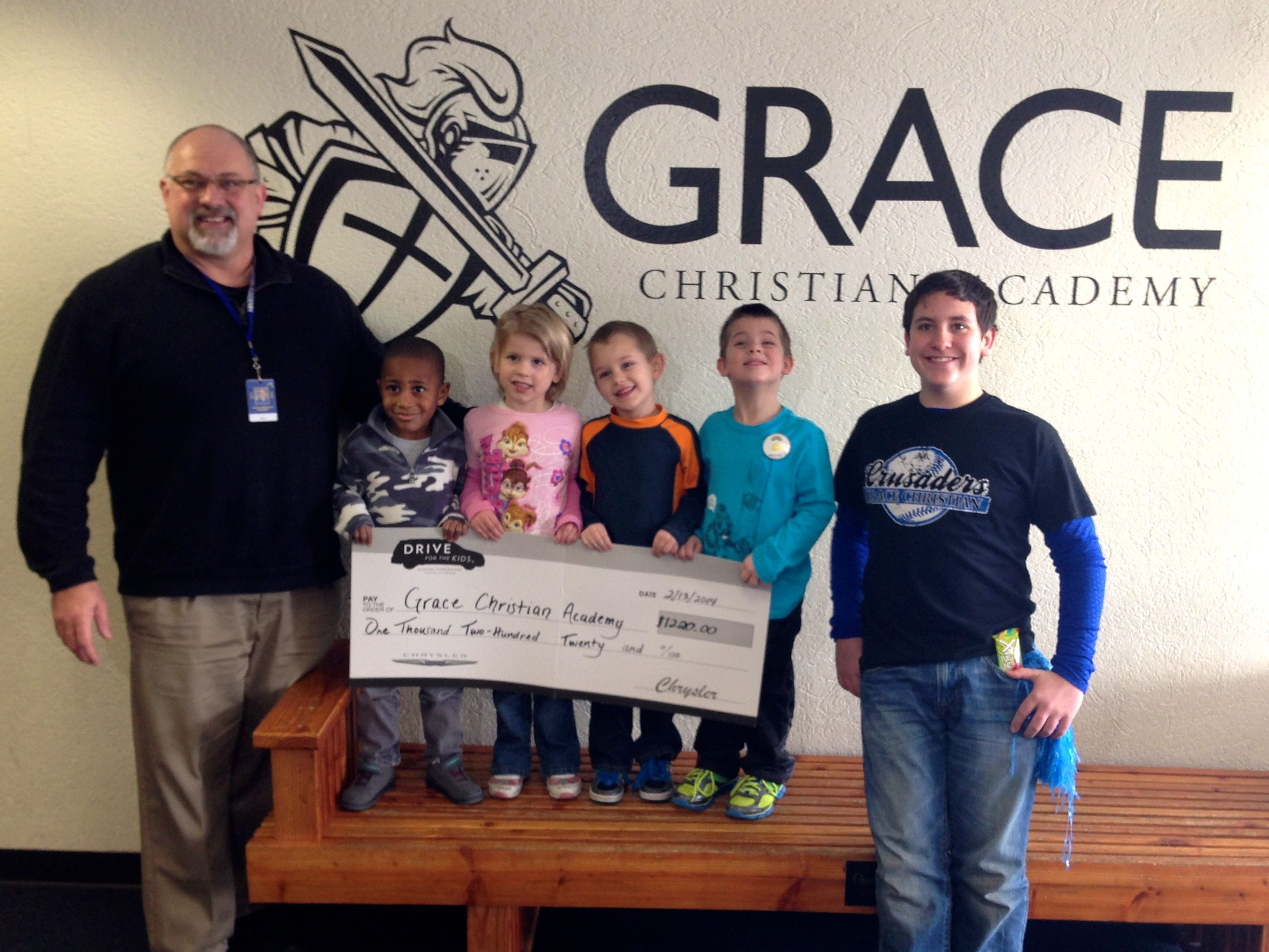 In November, Taylor helped Grace Christian Academy raise money through Chrysler's Drive for the Kids program. Today, they received their check for $1,220! We had a great time at their annual craft fair and enjoyed being able to help kids in our community.