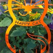 The Happy Cat Garden Stake is the perfect addition to any garden.  The stake allows you to put your new kitty in your favorite pot or flower bed.  Remove the stake and attach to decks, fences or gates.  Individually serial numbered.  Available in two colors, Orange Tabby (shown) and Green Eyed Kitty (sample below).  Made in the USA from heavy gauge steel and powder coated to last. All hardware included.  Preorders will ship by 9/17/12