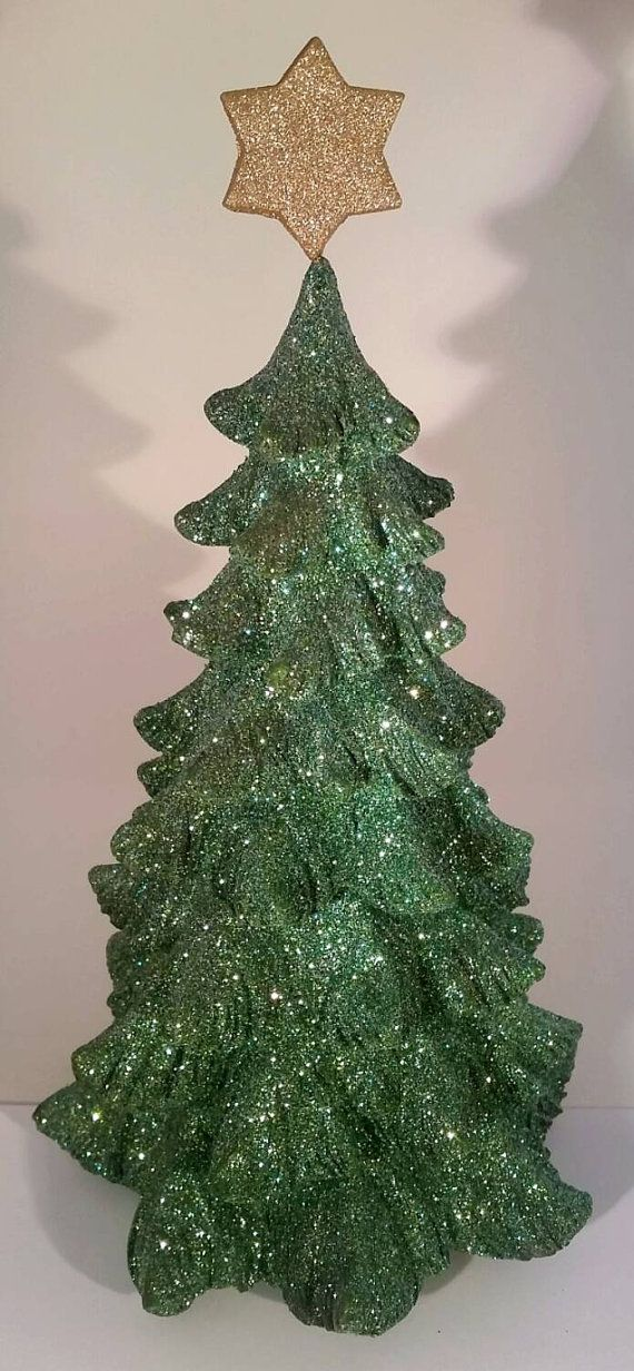 These green trees with Star of David tree toppers are sparkly and