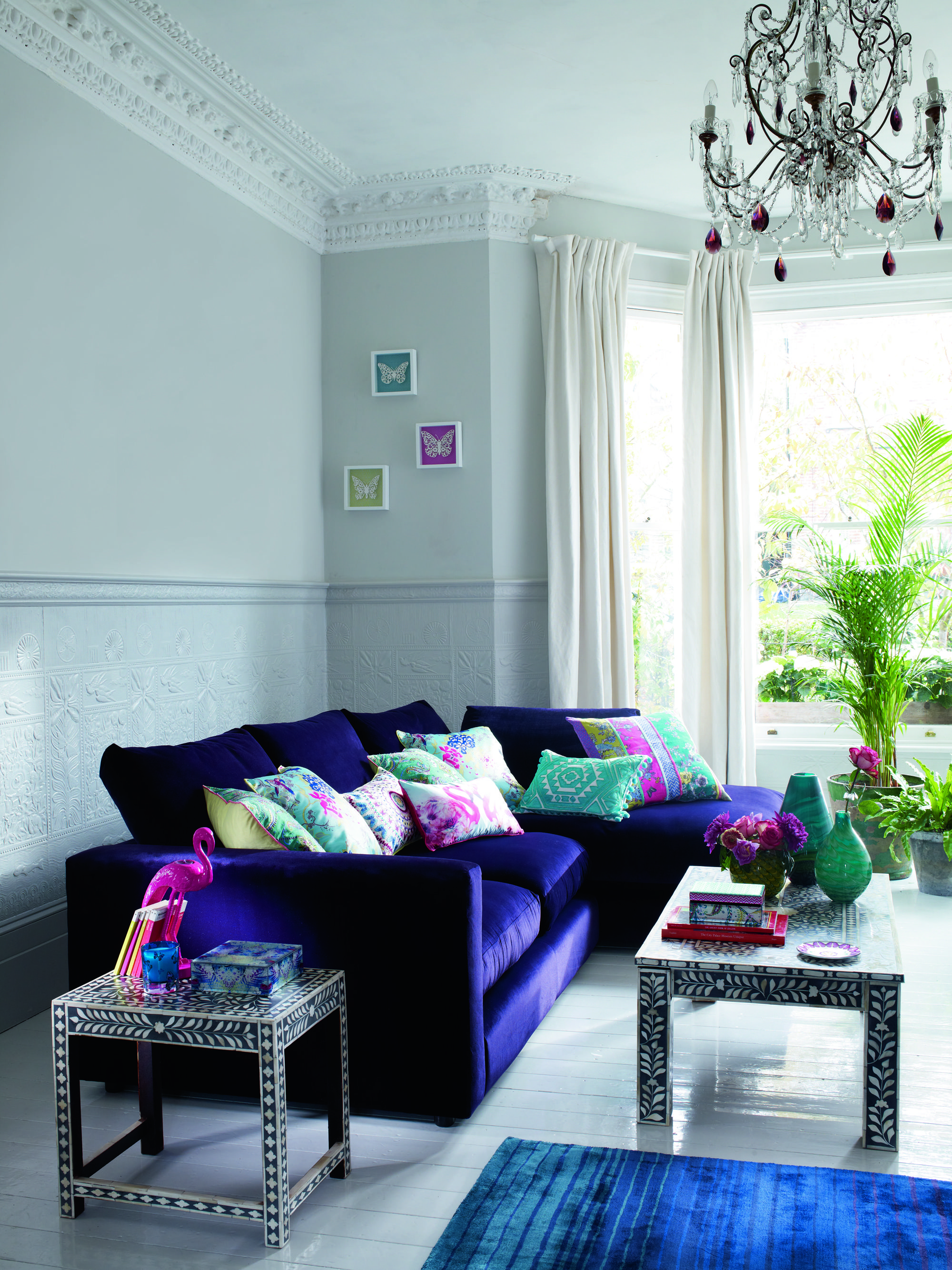 Bright Purple Sofa With Patterned Cushions Home Sofa Unique