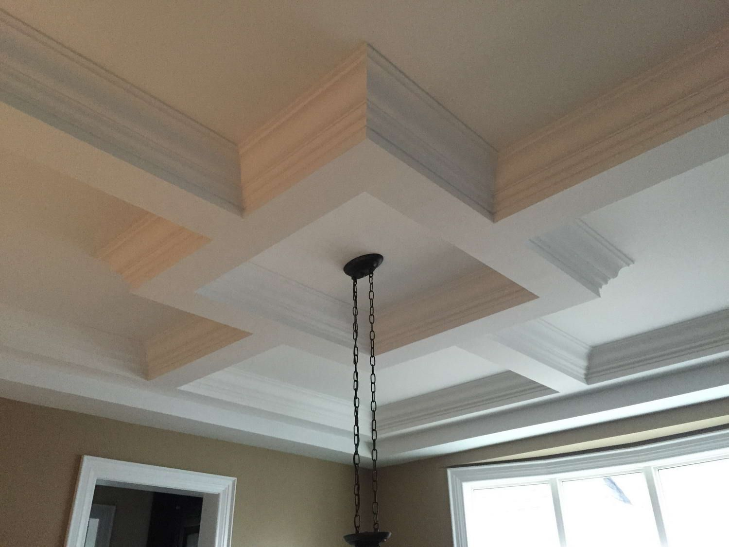 Get the best Coffered Ceiling in Toronto. We offer top-grade Crown Moulding installation, Trim Decoration, Wainscoting, Potlights & more. Call us.