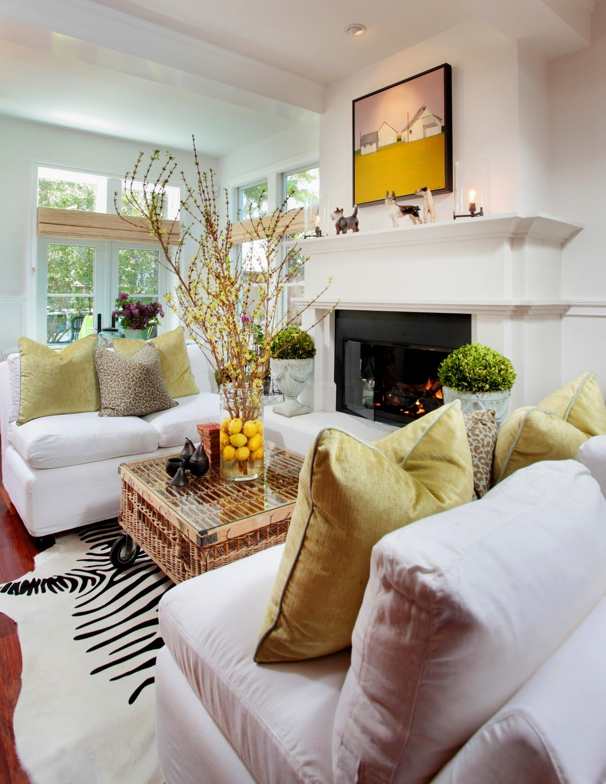 Neutral zebra rug coffee table wicker crate on casters for Living room ideas with zebra rug