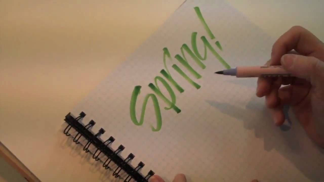 Brush lettering with zig scroll and brush markers illustrated