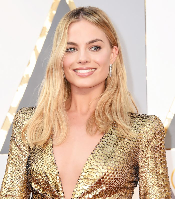 Margot Robbie is the definition of a golden goddess with her gorgeous blonde waves and her glowing skin