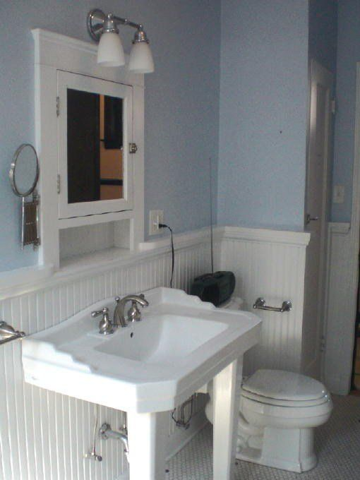 Pedestal Sink With Wide Counterspace Wainscoting Bonus Space