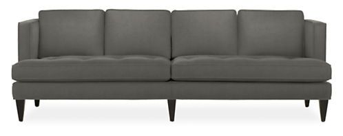 Vintage sophistication meets modern comfort in our Hutton sofa. The deep seat plays off the formal style of the welted box cushions for curl-up comfort that maintains a tailored appearance. Hutton features romantic details like a button tufted seat, rich fabric and tapered wood legs.