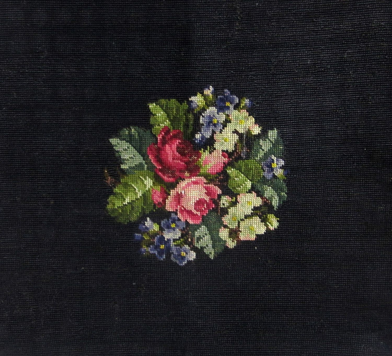 Vintage cushion cover floral bouquet in black background