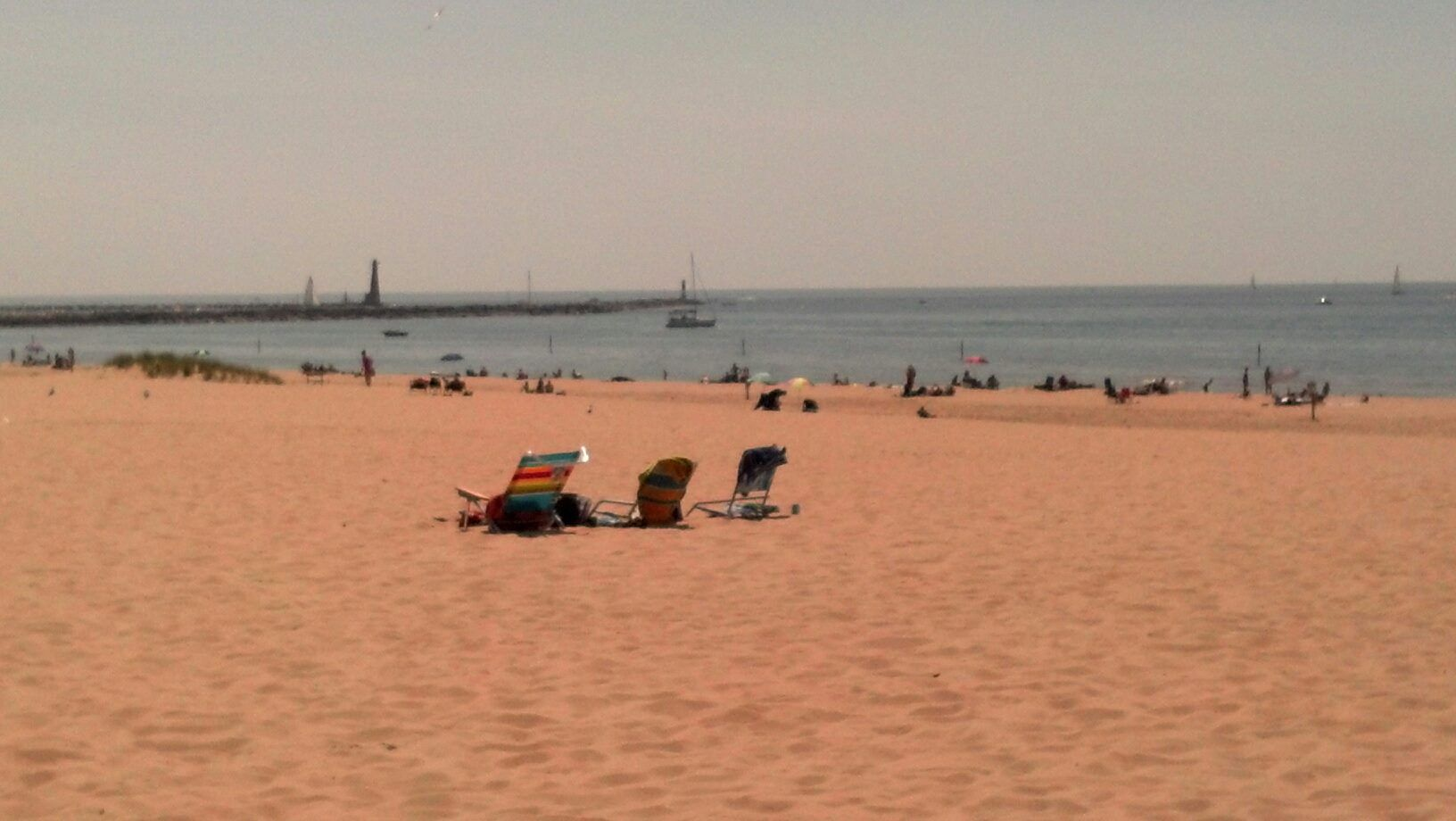 Muskegon State Park beach.....swimmers, sun bathers, boaters, lots of fun happening here.