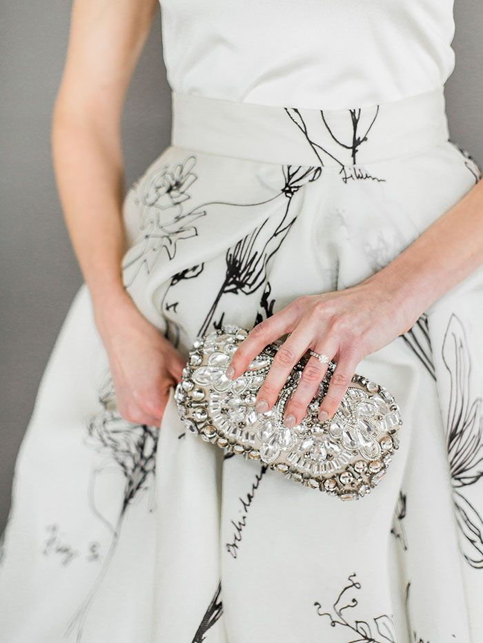 White and Black Patterned Wedding Dress with a Crystal Clutch