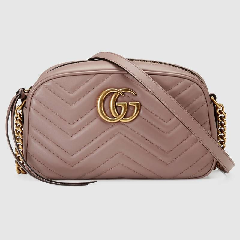 9cead555146 Shop the GG Marmont small matelassé shoulder bag by Gucci. The small GG  Marmont chain shoulder bag has a softly structured shape and a zip top  closure with ...