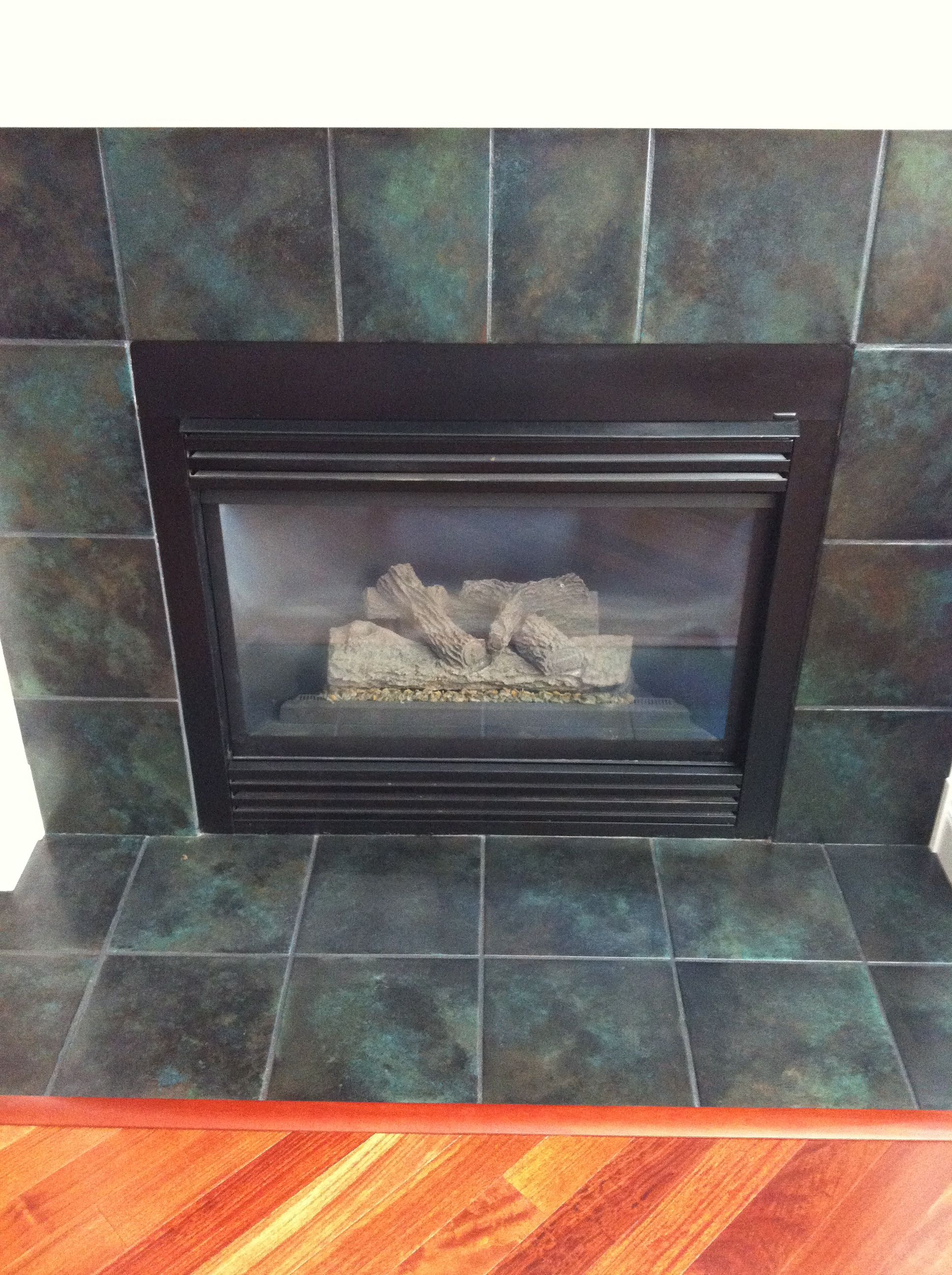faux painted tile on fireplace was shiny hunter green
