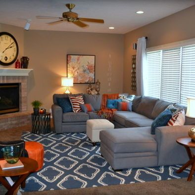 Gray orange blue family room design basement decor for Grey orange living room