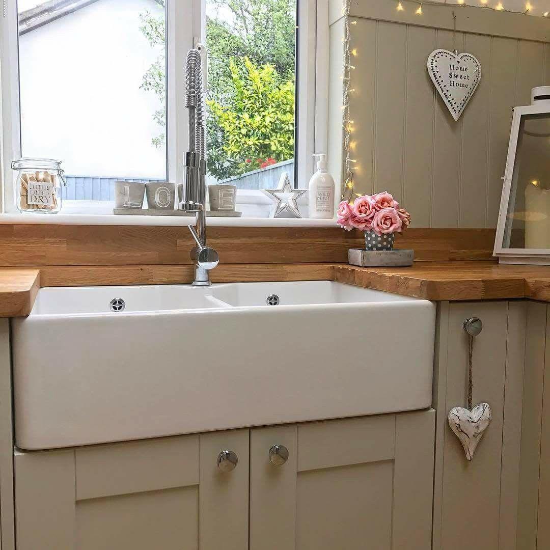 Low window behind kitchen sink  kristenandbellehomeinteriors  kitchen  pinterest