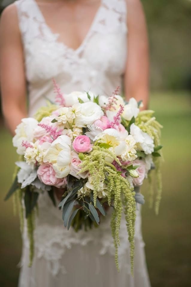 garden inspired soft bouquet of white peonies blush garden roses ranunculus lisianthus and