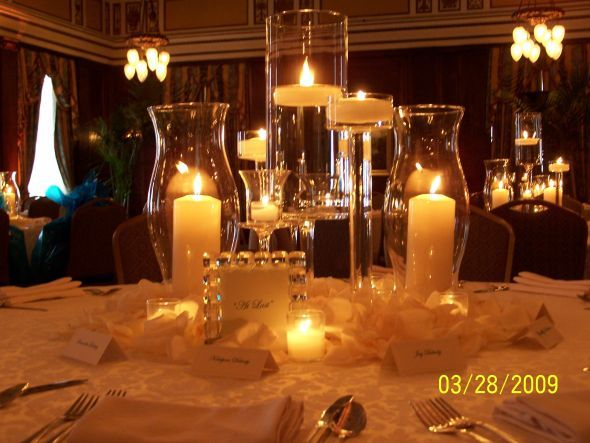 Candle only centerpiece with pillars and floating candles