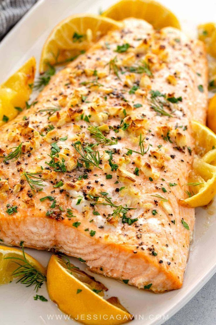 Baked salmon recipe seasoned with garlic, roasted lemons, and fresh herbs. A healthy family dinner ready in just 30 minutes.