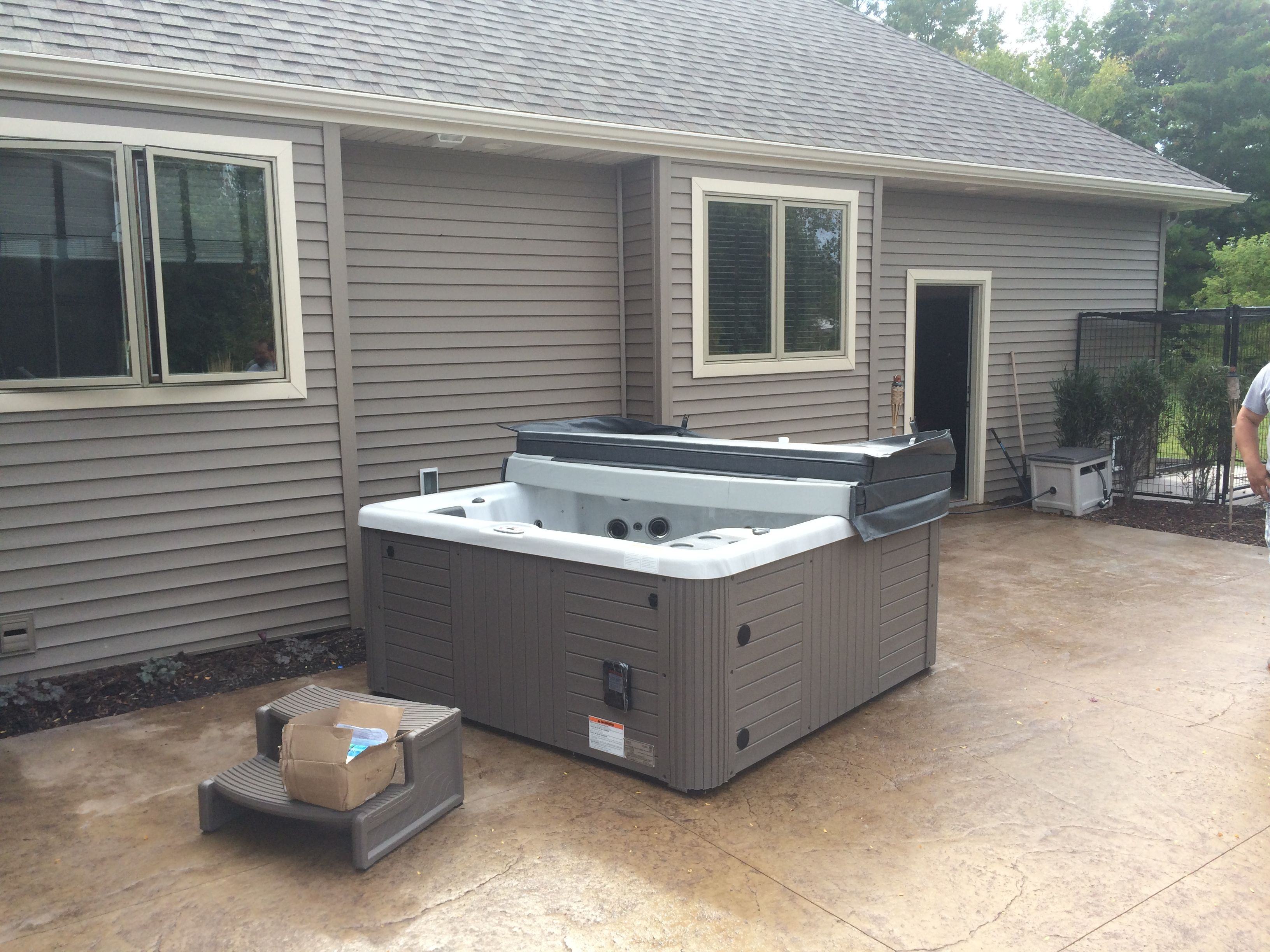 Here is a Master Spas Legacy spa installed on a concrete patio.