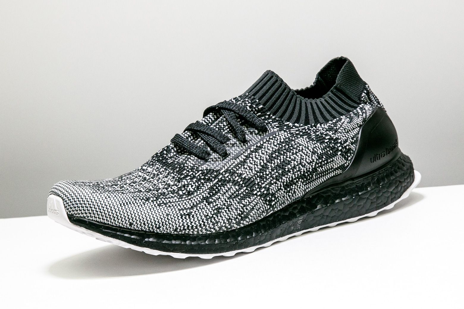 cbc5a018491 The Ultra Boost Uncaged returns in a clean black and white color scheme  with a glitch