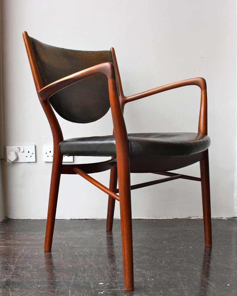 Finn Juhl; #NV46 Teak and Leather Armchair for Niels Vodder, 1946.