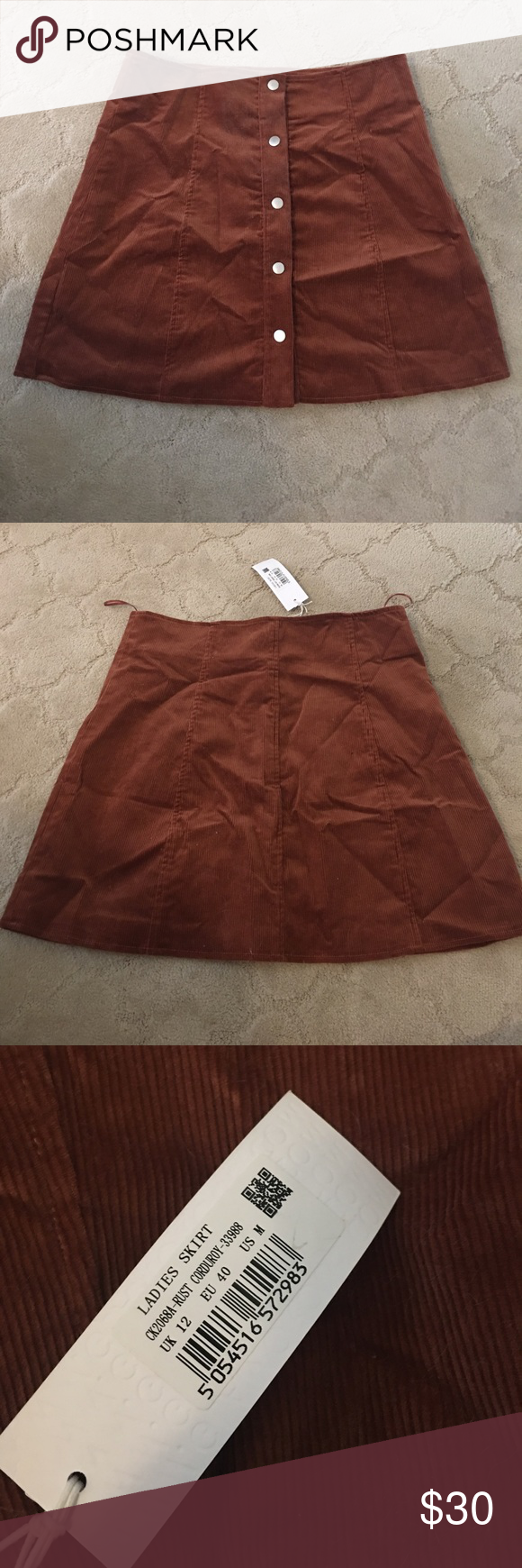 Corduroy Button-up Skirt Rust colored corduroy skirt with silver buttons. New with tags Skirts Mini