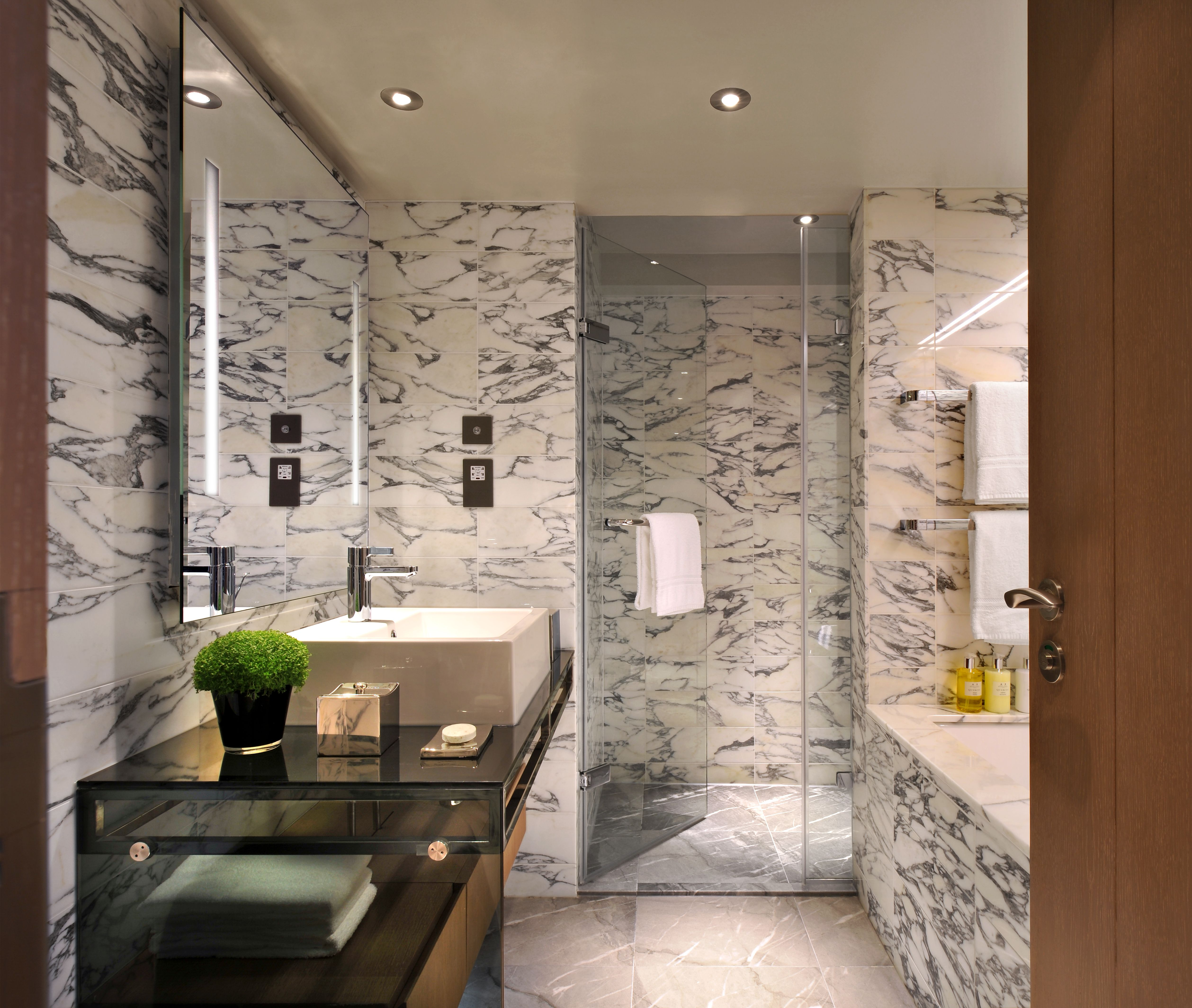A Modern Arabeo Marble Bathroom With Walk In Rainforest Shower The Hari Suite