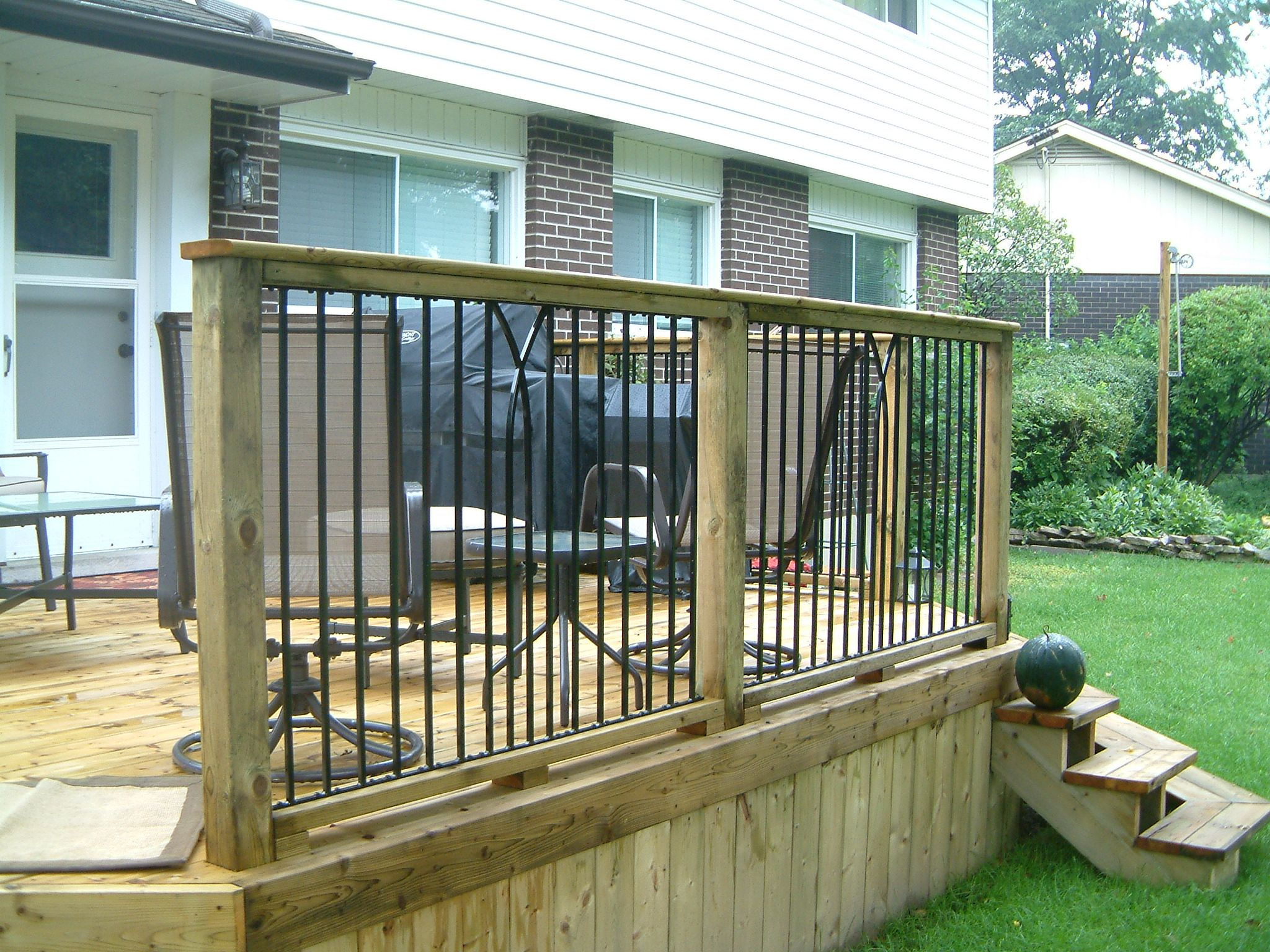 Best Pressure Treated Railing With Ornamental Iron Insert Deck 400 x 300