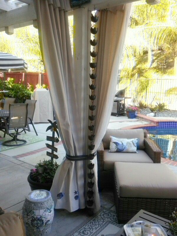Stencilled drop cloth patio curtains.......so easy yet so pretty.  And much less expensive than ready made curtains.