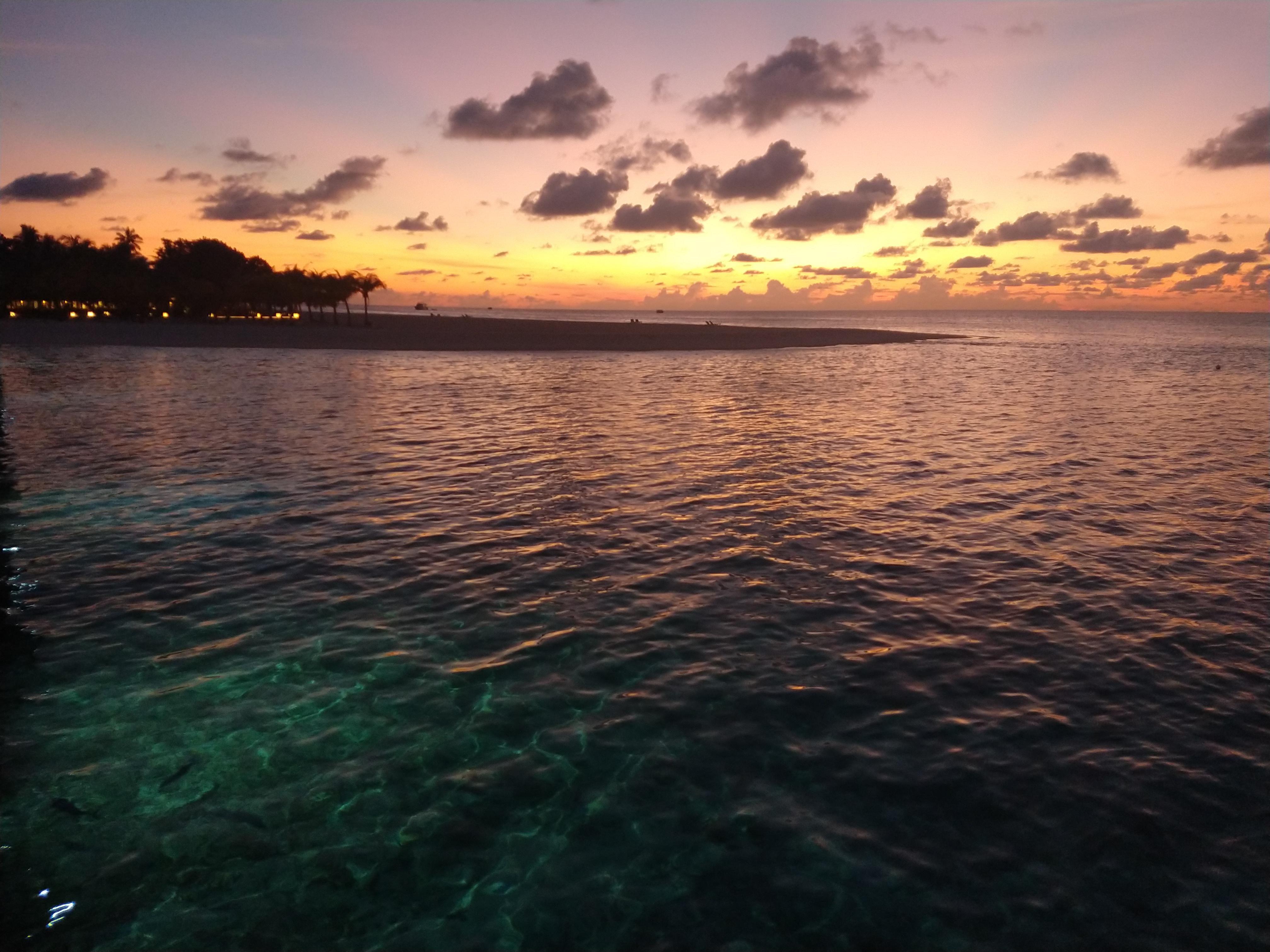 Meeru island maldives sunset from an overwater villa