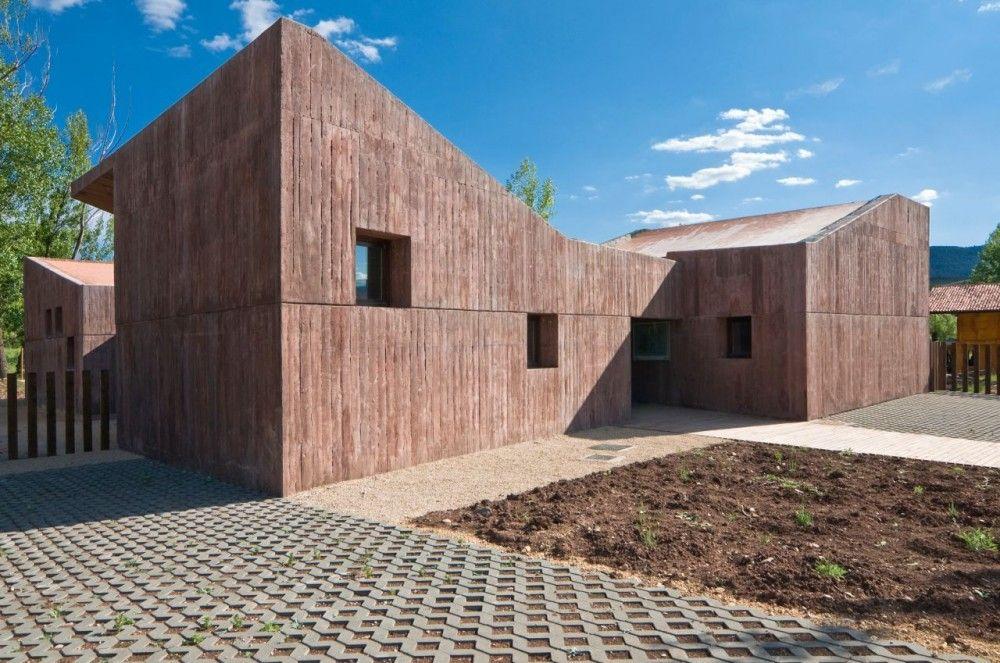 Interpretation Center in Valdemeca, Spain, by dra arquitectos (concrete walls look like rammed earth)