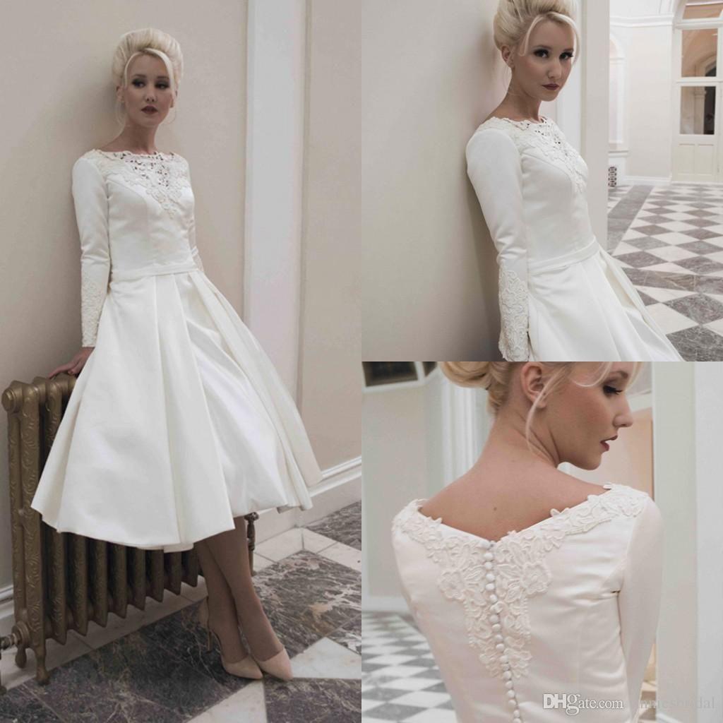 ivory tea length wedding dress with sleeves