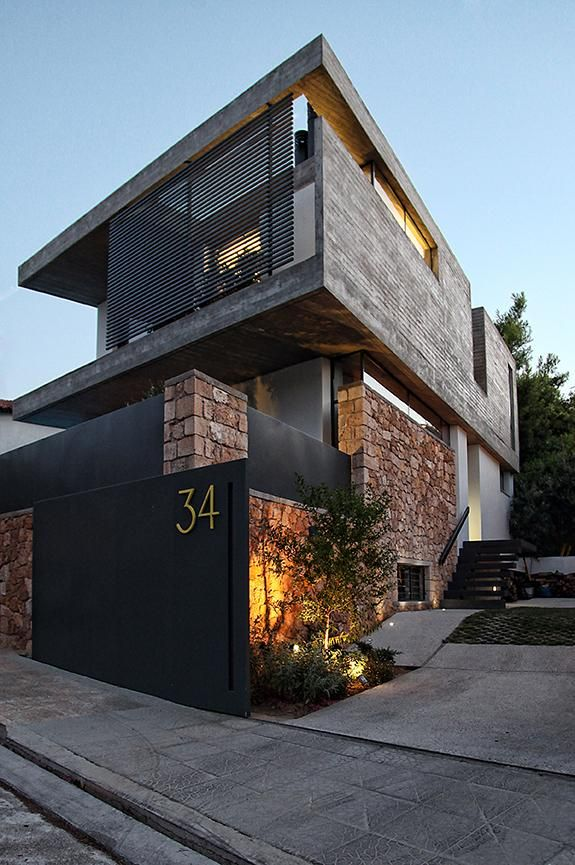 sleek athens house blends stone with concrete textures. Black Bedroom Furniture Sets. Home Design Ideas