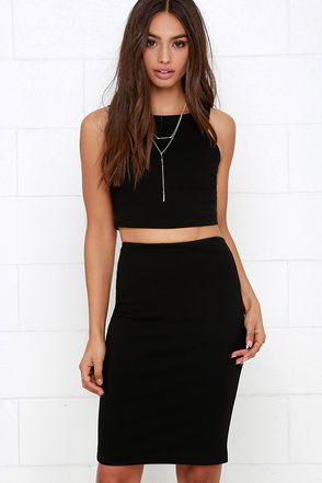 """Get the coveted crop top and matching skirt look in a snap with the Double Entendre Black Two-Piece Dress! This medium-weight stretch knit crop top has a deep sleeveless cut, a bodycon fit, and darted side accents. Matching midi skirt includes a comfortable elastic waistband. Top and skirt have hidden back zippers. Fully lined. Small top measures 14"""" long. Small bottom measures 23"""" long. 62% Viscose, 33% Nylon, 5% Spandex. Lining: 100% Polyester. Dry Clean Only. Made With Love in the U.S.A."""