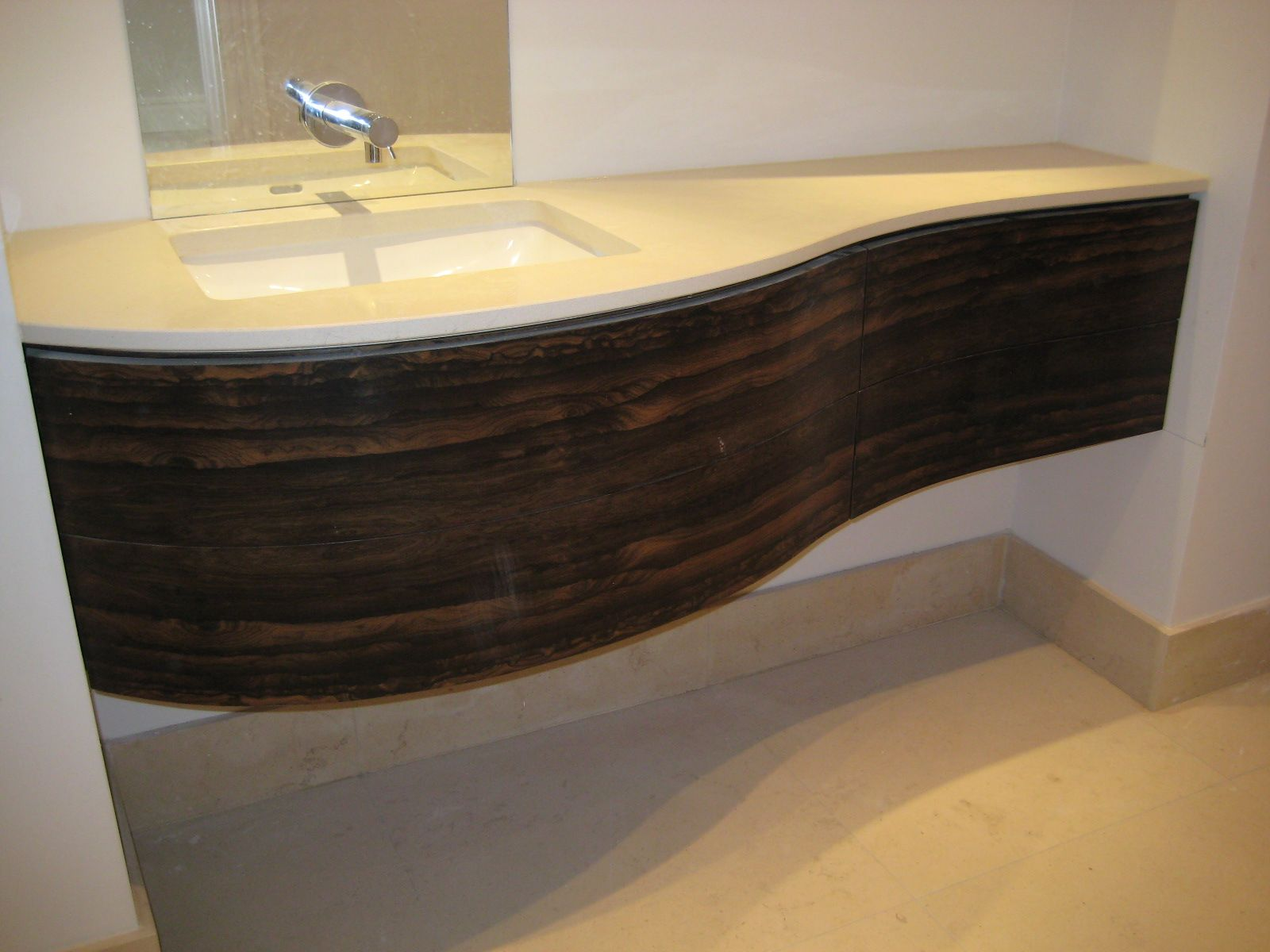 Ziricote finished floating vanity unit with seductive curve and comp -  Floating vanities