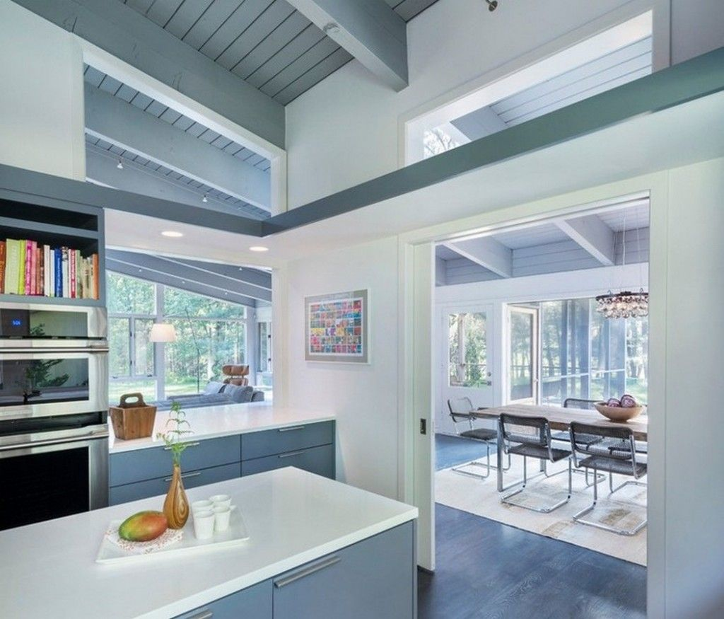 Modern Minimalist Kitchen With White Lamine Countertops And Grey ...