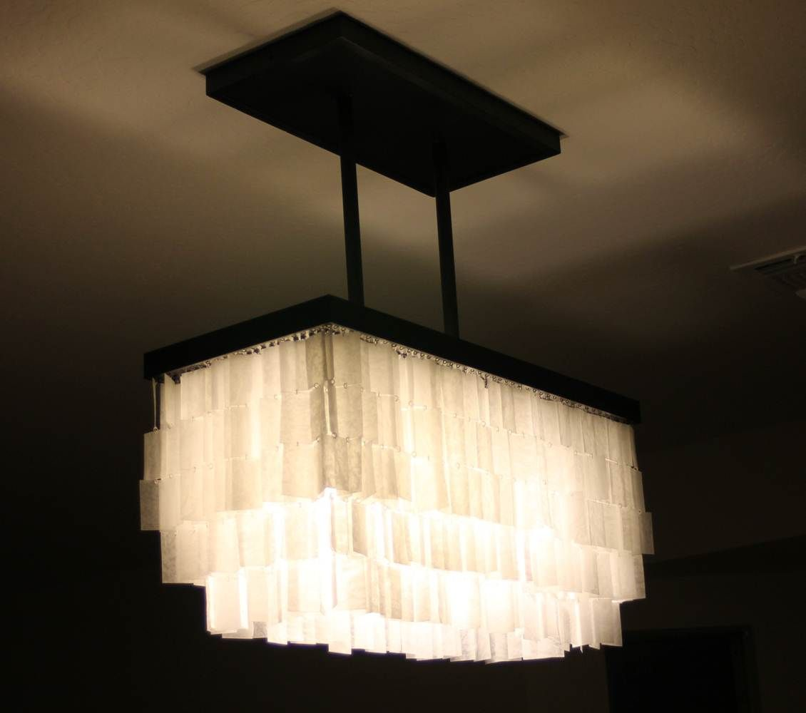 A Happy Place Called Home Made This Amazing Light Fixture With An Ikea Frame And Wax Paper Diy Chandelier Home Diy Light