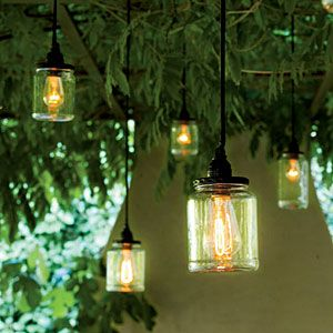 Shed New Light on Canning Jars... Peel off the labels of pickle and okra jars, and use a cord kit (paperlanternstore.com) to illuminate each one. Equipped with a dimmer and hung at varying heights, they provide the ideal mix of rustic and industrial.