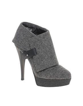 One button platform ankle boot.
