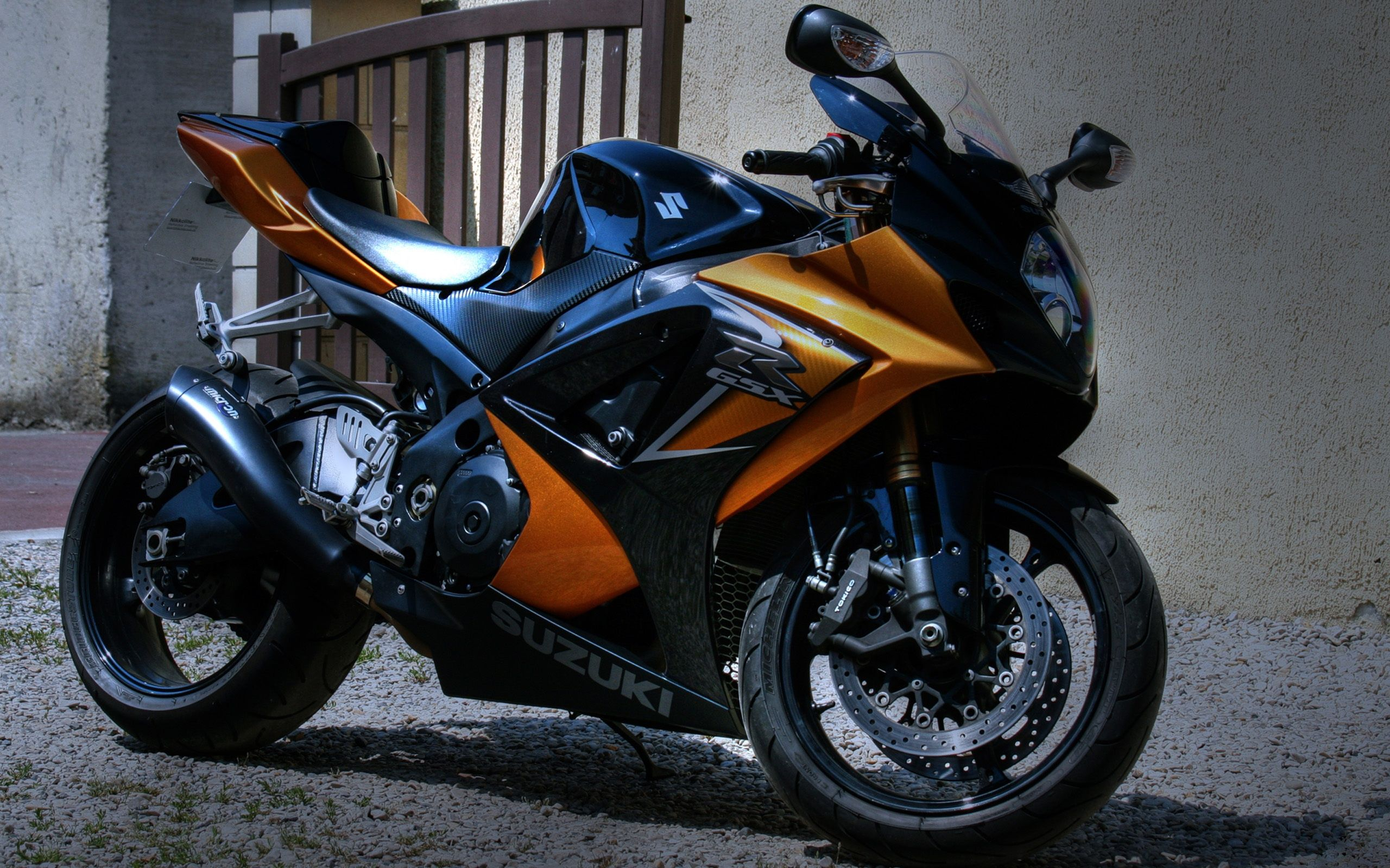 Suzuki Motorcycle Parked Outside The House Wallpaper 2560x1600