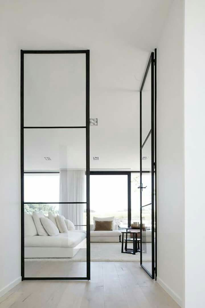 Gorgeous minimalist interior with white walls and black steel frame ...