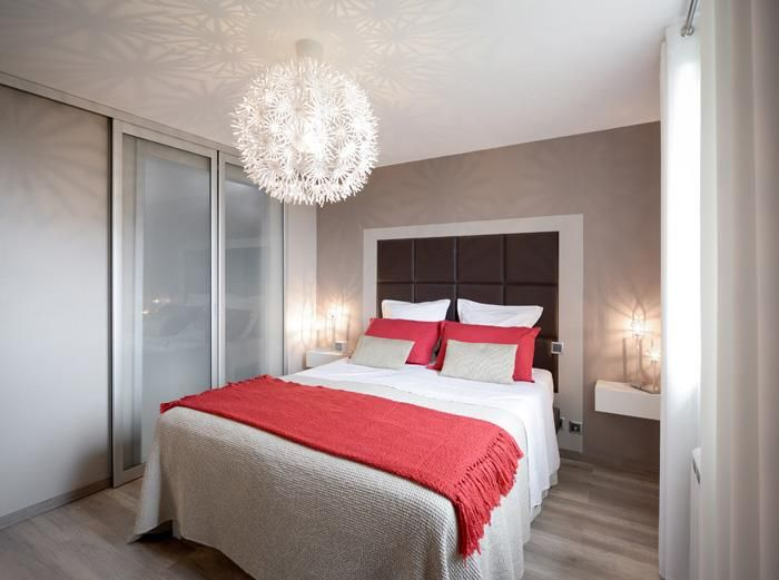 Contemporary style bedroom combining the colors red, white, taupe