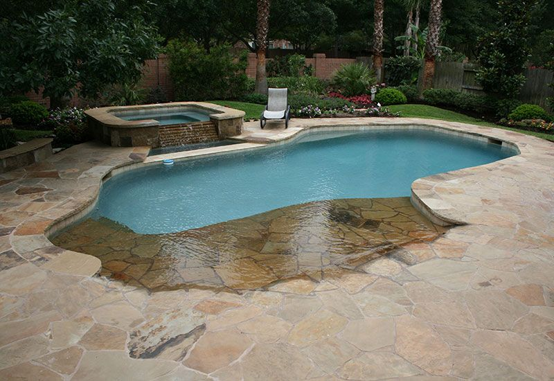 Backyard swimming pool with beach entry and fire pit for Pool design with beach entry